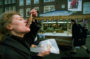 Woman Eating Dutch Herring
